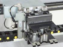 Зажимы гибкого сверлильного центра с ЧПУ Morbidelli UX 200, производство SCM Италия