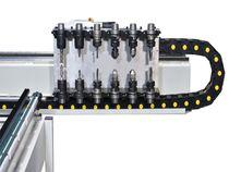 Двухфрезерный двигатель с двойным устройством смены инструмента гибкого сверлильного центра с ЧПУ Morbidelli UX 200, производство SCM Италия