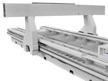 Неподвижный рабочий стол и подвижный портал обрабатывающего центра с ЧПУ для обработки столярных изделий из массива древесины Accord 25 fx